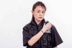 Chinese female police officer on radio. Chinese female police officer calling in on radio Stock Image