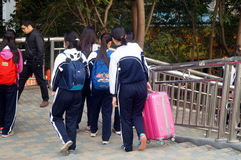 Chinese female students walk in the street Royalty Free Stock Photo