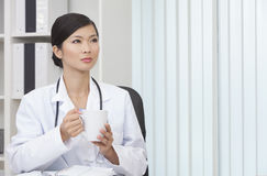 Chinese Female Woman Doctor Drinking Coffee or Tea Royalty Free Stock Image