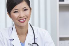 Chinese Female Woman Hospital Doctor Hospital Office. A smiling happy Chinese Asian female medical doctor in a hospital office Stock Photos