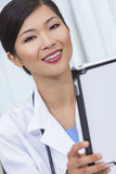 Chinese Female Woman Hospital Doctor Using Tablet Computer Stock Photos