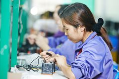 Chinese female worker at manufacturing Stock Photo