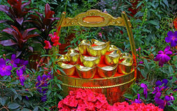 Chinese feng shui gold ingots and wealth pot Royalty Free Stock Photo
