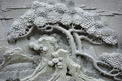 Chinese Feng Shui pine tree carving royalty free stock photo