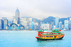 Chinese ferry boat. Hong Kong. Traditional chinese-style boat sailing in Hong Kong harbor Stock Photos