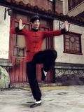 Chinese fighter in black and red clothes Stock Photo