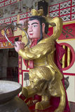 Chinese figure at shrine Stock Photo