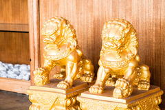 Chinese figurine golden singha partner Stock Photo