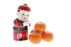 Chinese Figurine and Mandarins Stock Images
