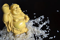 Chinese figurine in rice. Chinese figurine by funny man in rice Stock Image