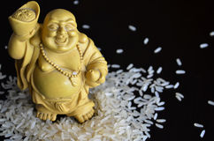Chinese figurine in rice. Chinese figurine by funny man in rice Stock Photo