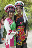 Chinese Film Extras in Bai Clothing. Chinese girls dressed in traditional Bai peoples clothing for the TV show Wind Flower Snow Moon,' filming in Dali, Yunnan Royalty Free Stock Photos