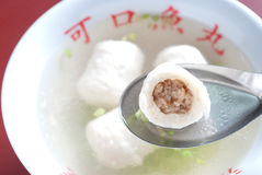 Chinese fish ball soup with sliced meat inside. Chinese fish ball soup in Taiwanese style with coriander and celery, sliced meat inside Royalty Free Stock Image