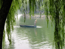 Chinese fisherman. Fisherman cleaning the lake near the Summer palace Beijing China Royalty Free Stock Photography