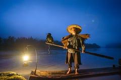 Chinese Fisherman. Cormorant fisherman and his birds on the Li River in Yangshuo, Guangxi, China Stock Image