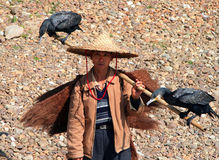 Chinese fisherman with two cormorants on his shoulder, Guangxi Province Stock Photos