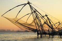Chinese fishing net at sunrise in Cochin (Fort Kochi). Kerala, India royalty free stock photos