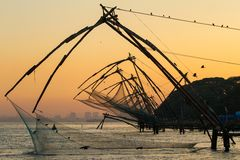 Chinese fishing net at sunrise in Cochin stock photography