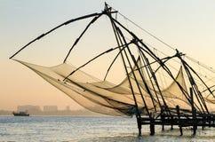 Chinese fishing net at sunrise in Cochin. (Fort Kochi), Kerala, India royalty free stock photos
