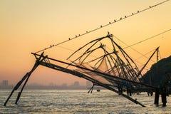 Chinese fishing net at sunrise in Cochin (Fort Kochi) stock photos