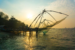Chinese fishing net at sunset in Cochin royalty free stock photo