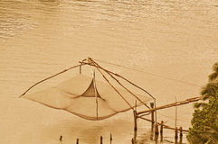 Chinese fishing net. A telephoto shot from high angle and long distance, this large Chinese fishing net is in the banks of backwaters Royalty Free Stock Images