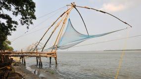 Chinese fishing nets. Many chinese fishing nets dot the shore in Cochin, India Stock Image