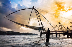 Chinese Fishing nets. At dramatic sunset sky background on Vypeen Island in Kochi, Kerala, India stock photo