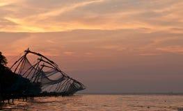 Chinese fishing nets. Sunset over chinese fishing nets in Kochi stock photography