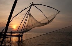 Chinese fishing nets. Sunset over chinese fishing nets in Kochi Royalty Free Stock Photography