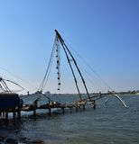 Chinese fishing nets. Fisherman and the Chinese fishing nets of Fort Cochin, January 2017 Stock Images