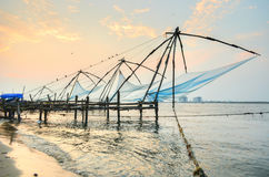 Chinese fishing nets of fort cochin. Chinese fishing nets are fixed land installations for an unusual form of fishing - shore operated lift nets. they are mostly Stock Images