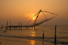 Chinese Fishing Nets. Fort Cochin, Kerala, India. Photo at sunset of Chinese Fishing nets located in southern India Stock Photos