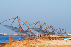 Chinese Fishing nets. Fort Kochi, India - Jan 6, 2015: Tourists wait for sunset near Chinese Fishing nets in Fort Kochi. Kerala. India Royalty Free Stock Images