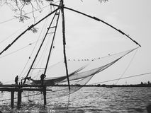 Chinese Fishing Nets in Kochi. Silhouette of Chinese Fishing Nets in Kochi, India Stock Images