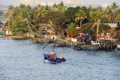 Chinese fishing nets. Modern Trawler and the Chinese fishing nets of Fort Cochin Stock Photography