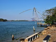 Chinese fishing nets. And the new Cranes of Fort Cochin Royalty Free Stock Photography