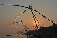Chinese fishing nets at sunrise royalty free stock photo