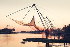 Chinese fishing nets on sunset background in Cochin, Kerala, Ind. Silhouette of Chinese fishing nets at sunset. Kochi, India Royalty Free Stock Image