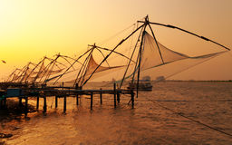 Chinese Fishing nets at sunset Stock Photos