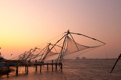 Chinese Fishing nets at sunset. Fort Kochi. Kerala. India Royalty Free Stock Images