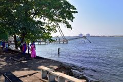 Chinese fishing nets. Tourists and the Chinese fishing nets of Fort Cochin Stock Images