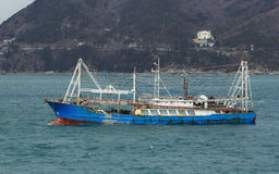 Chinese fishing vessel. Busan, South Korea – February 29th, 2016: Busan, road of the port of Busan, anchorage of sea vessels, the fishing boat Royalty Free Stock Photography