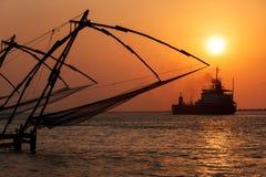 Chinese fishnets on sunset. Kochi, Kerala, India Royalty Free Stock Images