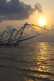 Chinese fishnets on sunset. Kochi, Kerala, India Royalty Free Stock Images