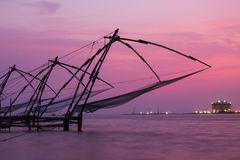 Chinese fishnets on sunset. Kochi, Kerala, India Royalty Free Stock Photo