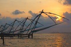 Chinese fishnets on sunset. Kochi, Kerala, India Royalty Free Stock Photography