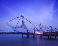 Chinese fishnets on sunset. Kochi, Kerala, India Royalty Free Stock Photography