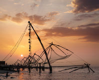 Chinese fishnets on sunset. Kochi, Kerala, India Royalty Free Stock Photo