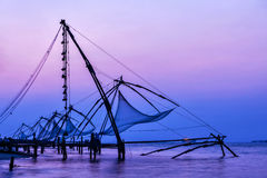 Chinese fishnets on sunset. Kochi, Kerala, India. Kochi chinese fishnets on sunset in Fort Kochin, Kochi, Kerala, India Royalty Free Stock Images